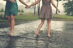 girls-playing-in-the-rain